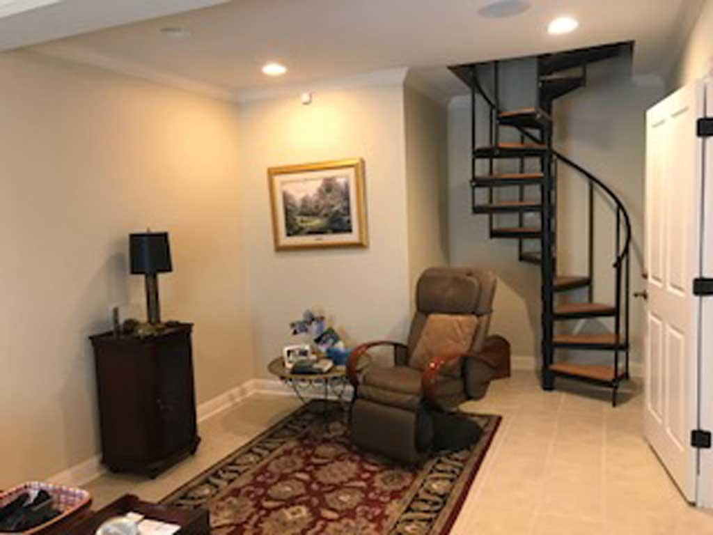 Office with spiral stairs to master bedroom